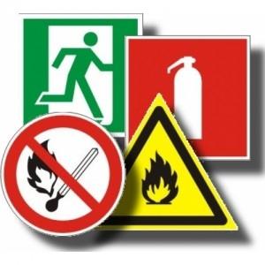 Знаки безопасности на пленке наклееной на пластик
